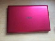 Компактный,  тонкий и легкий ноутбук ASUS X201E розового цвета.